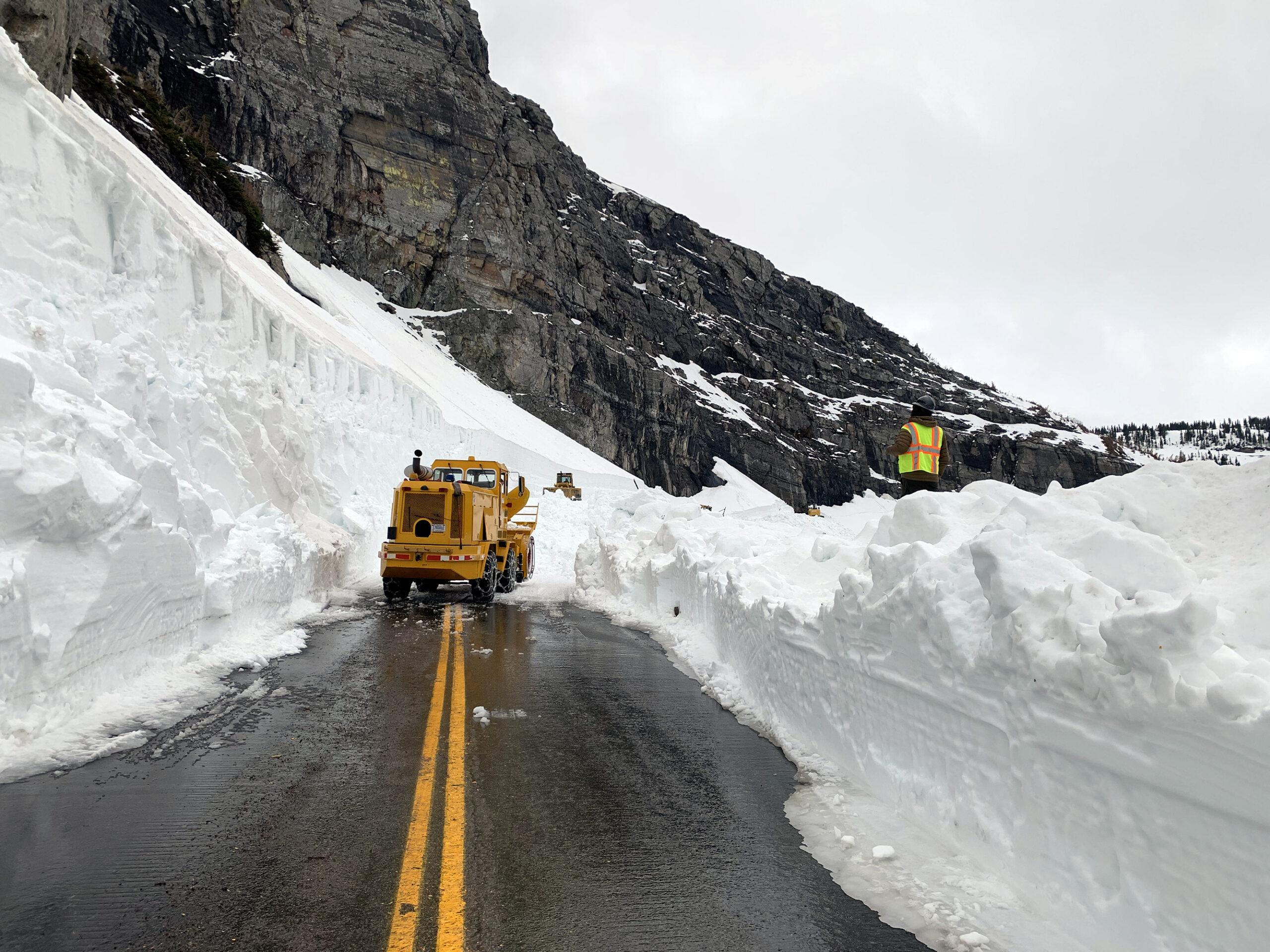 Snow plow crew nears Logan Pass